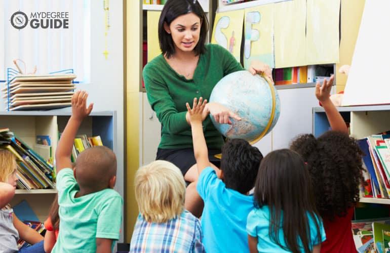 primary school teacher teaching kids