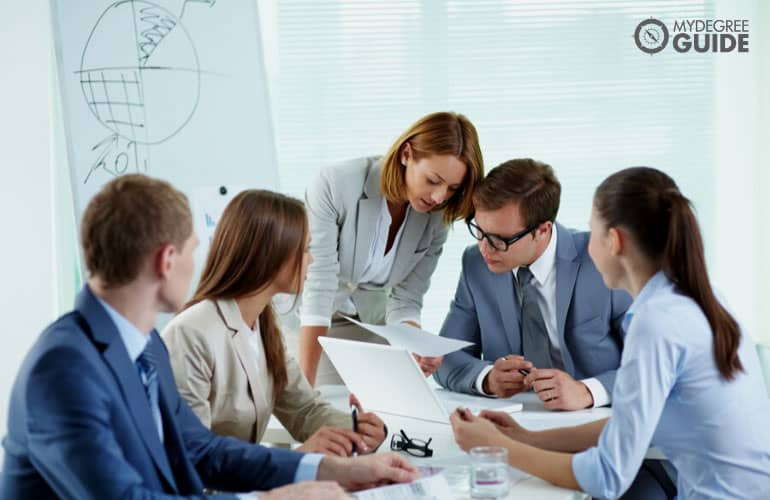 team of financial analysts in a meeting