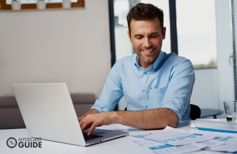 financial analyst working on his laptop