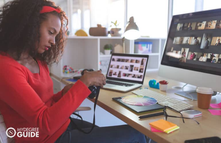 graphic designer checking images on her camera