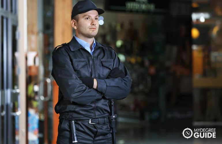 male security guard guarding a building