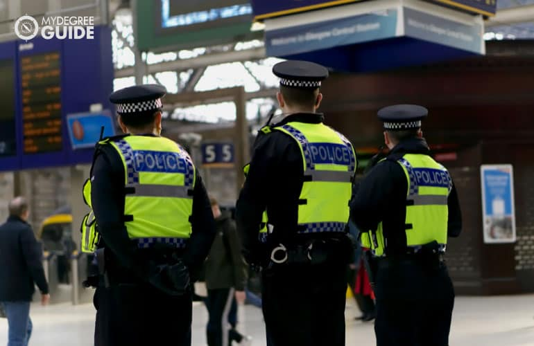police patrol on standby in a train station