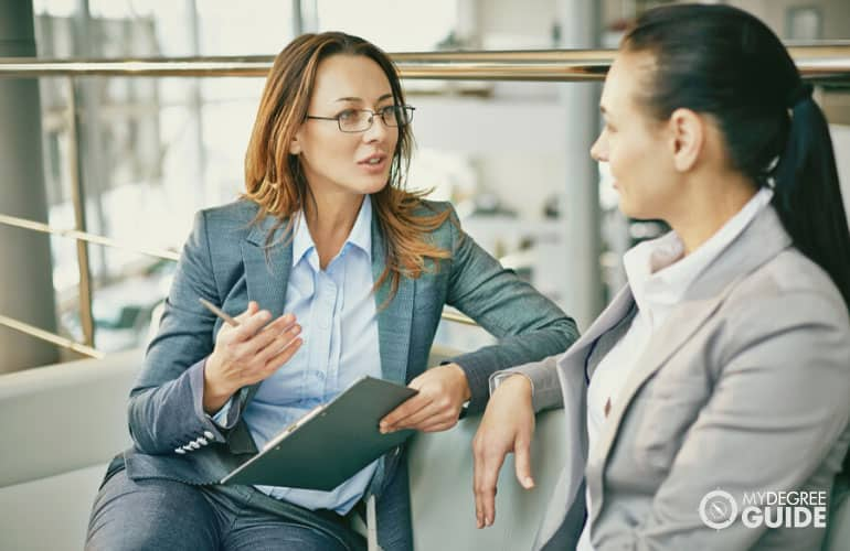 head of human resource department talking to an employee