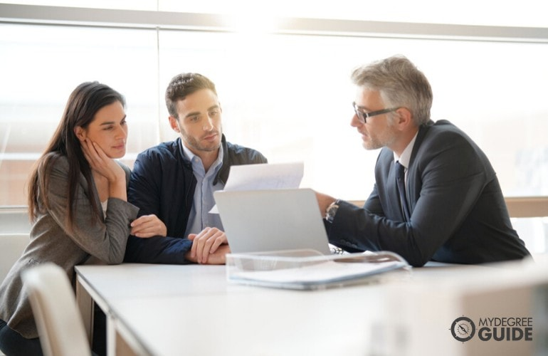 financial advisor meeting with his clients