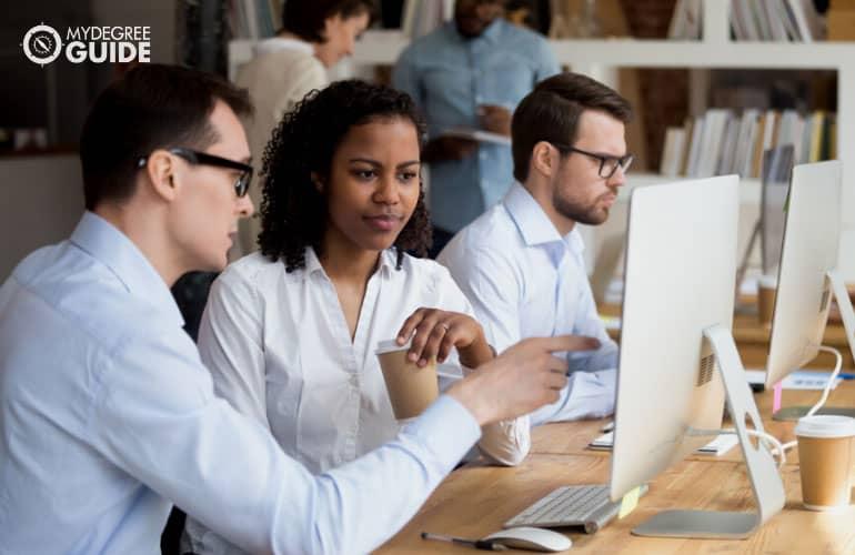 office manager mentoring an employee
