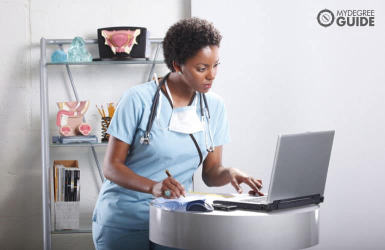 medical assistant working on her laptop