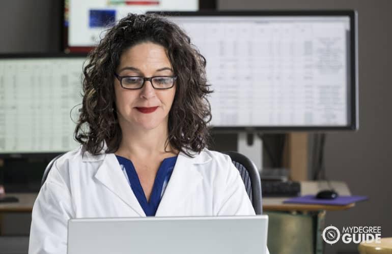 medical coder working on her laptop