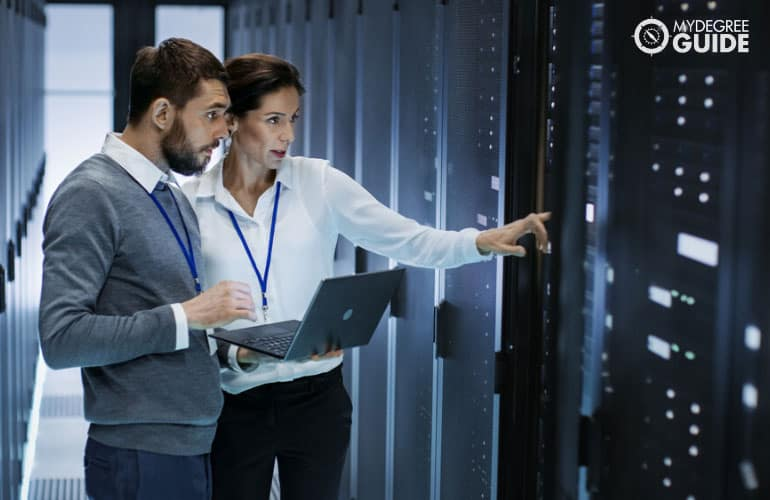 network administrator talking to a colleague in a database