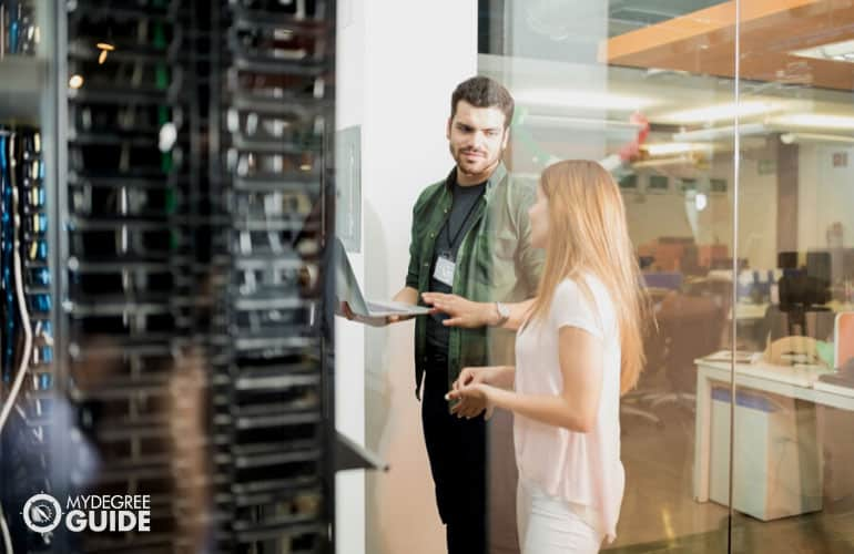 IT professionals standing in front of server room
