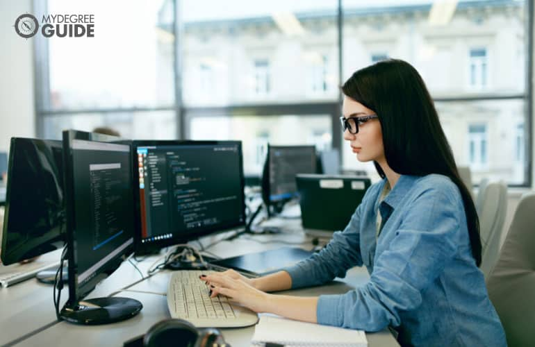 female computer programmer working in an office