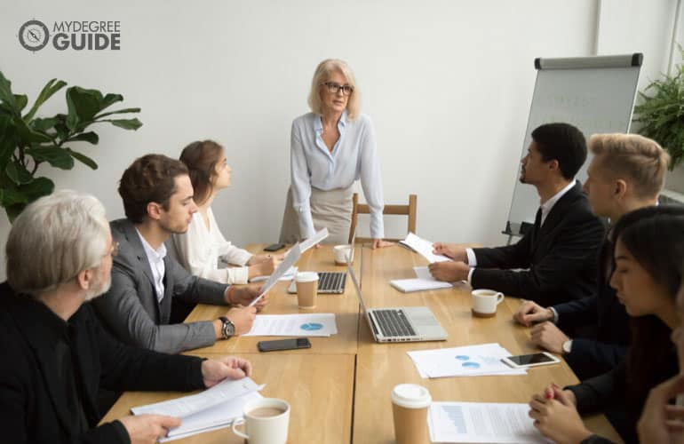 human resources director discussing during a meeting with other professionals