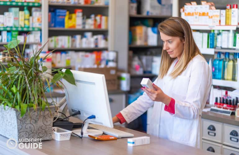 pharmacist checking a medicine on her computer