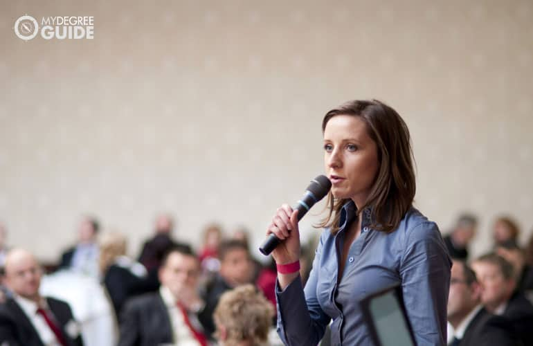 female manager speaking during a conference