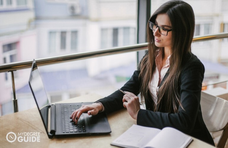 financial analyst working on her laptop