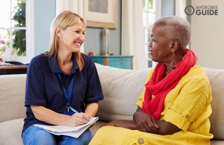 social worker talking to an elderly woman