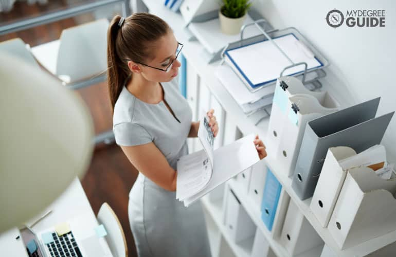 bookkeeper arranging documents in an office