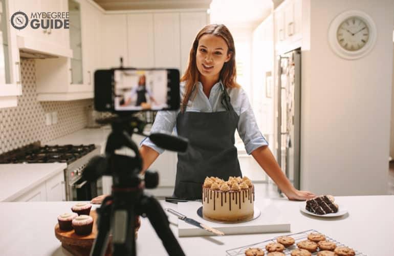 female baker vlogging herself to market her business
