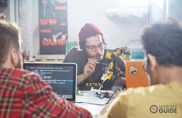 Engineering technician fixing a machine