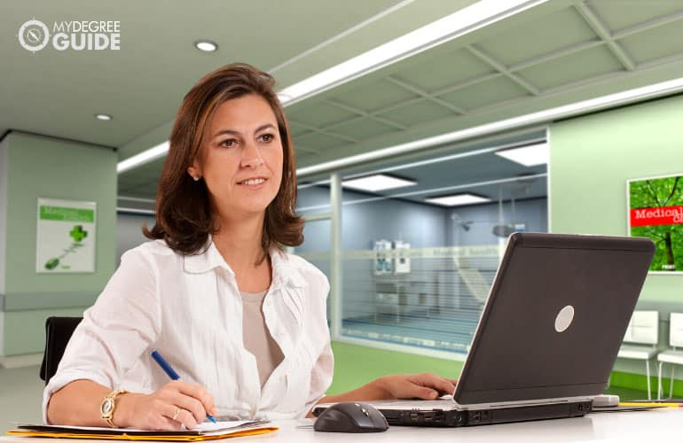 healthcare administrator working on a laptop
