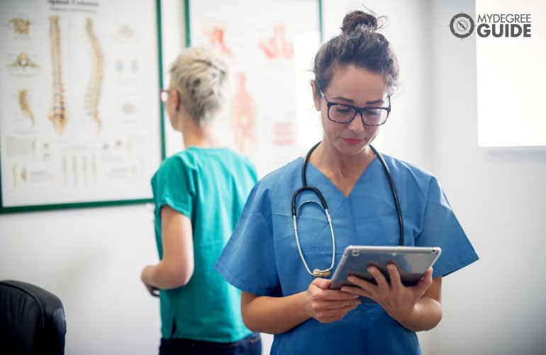 medical assistant looking at a tablet