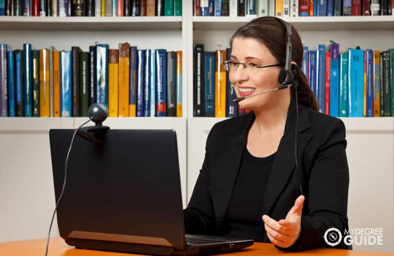 online teacher having a class in front of her computer