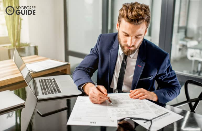 accountant checking financial reports