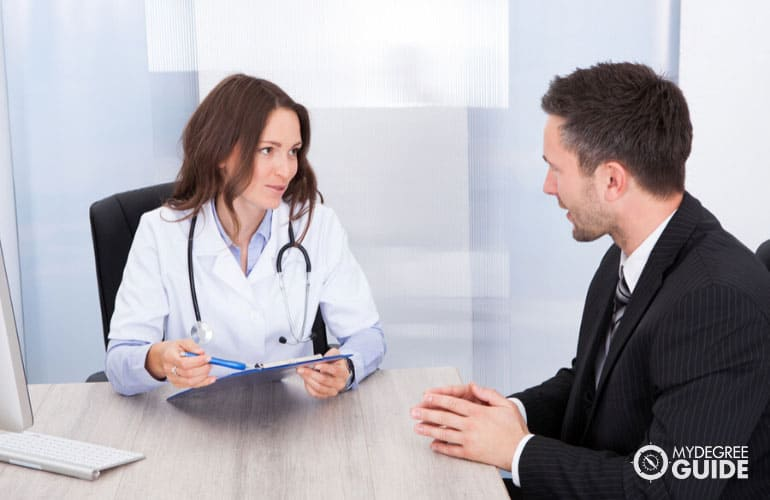 healthcare manager having a meeting with a doctor