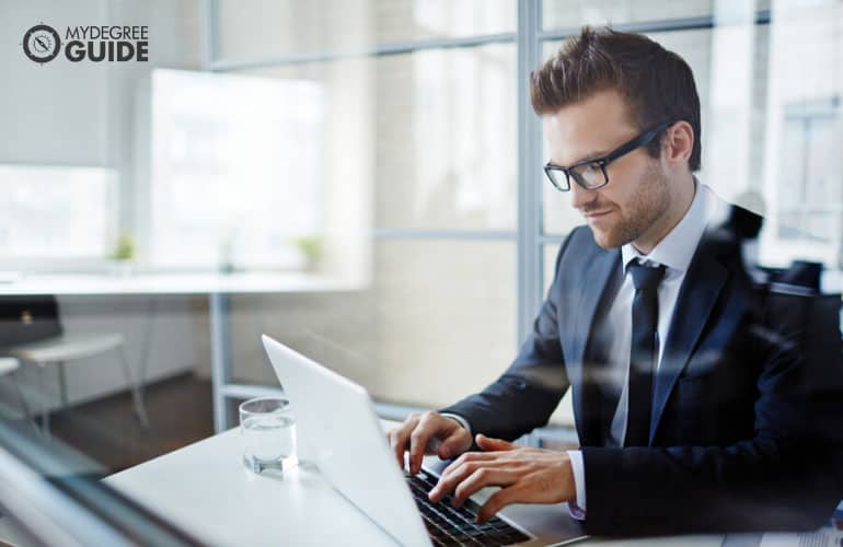 businessman working on her laptop