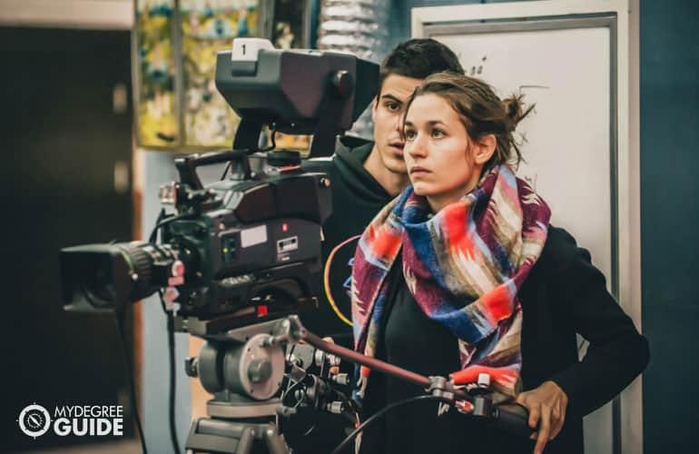 film director and camera man adjusting the camera