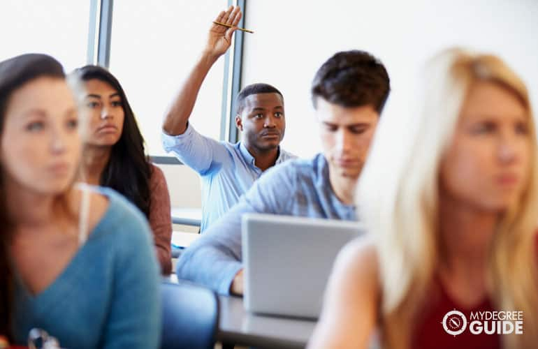 finance students listening to a professor during lecture