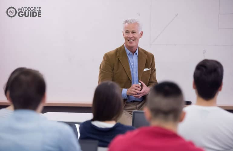 university professor doing a lecture in a classroom