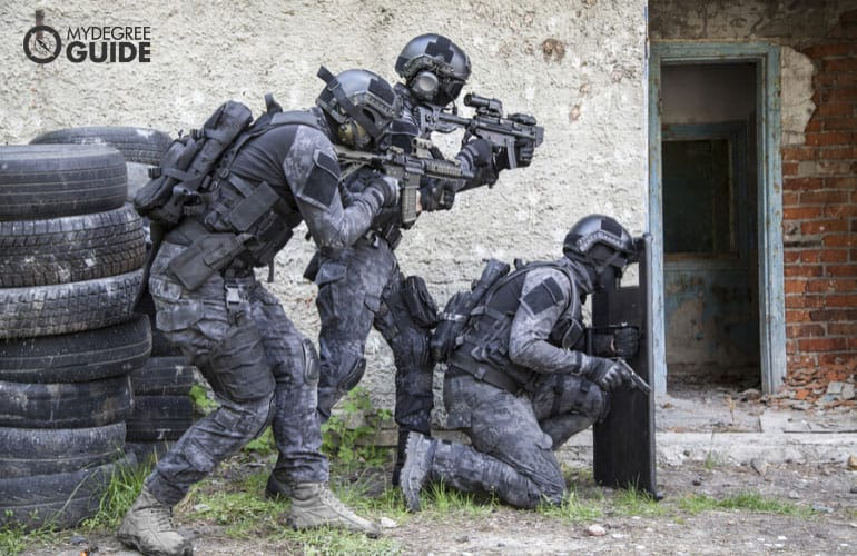 SWAT officers preparing to enter a building