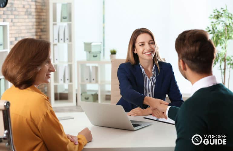 human resource manager talking to employees