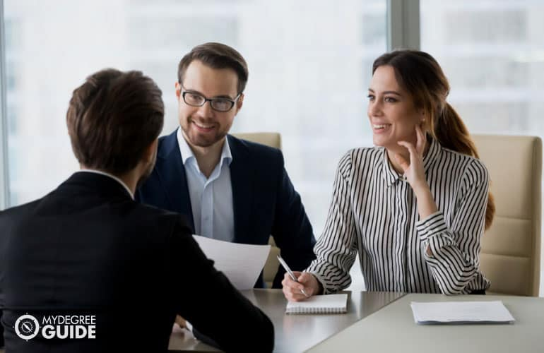 human resource managers interviewing a job applicant in an office