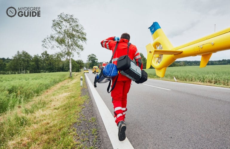 doctor running to help victims of a traffic accident