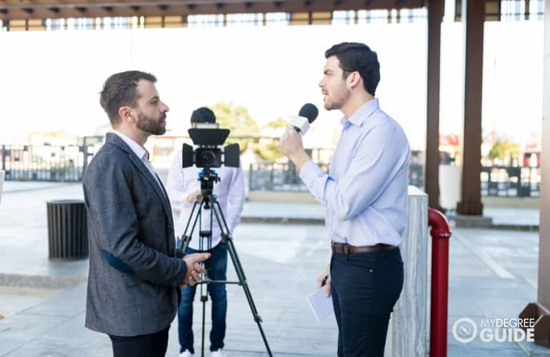 male journalist interviewing a businessman