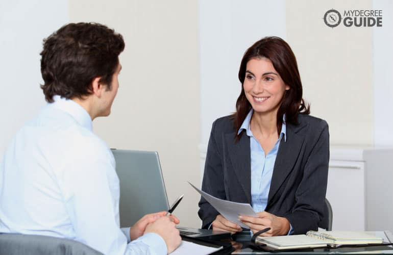 human resource manager interviewing a job applicant in an office