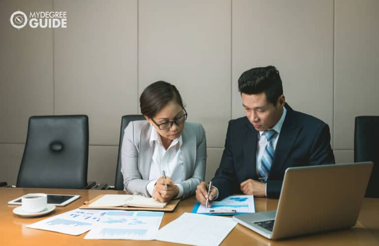 financial managers working together in a conference room