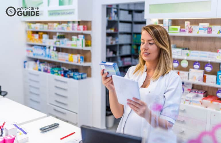 pharmacist checking the label of a medicine box