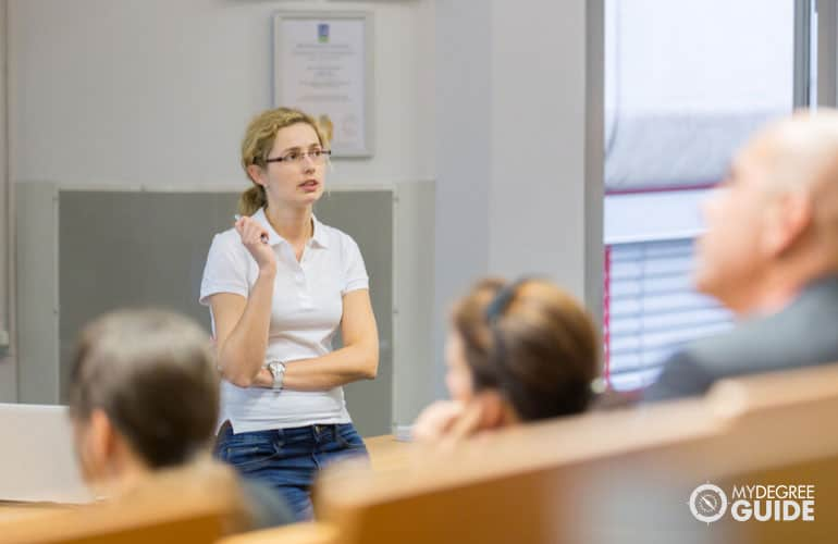 health educator speaking in public during health conference
