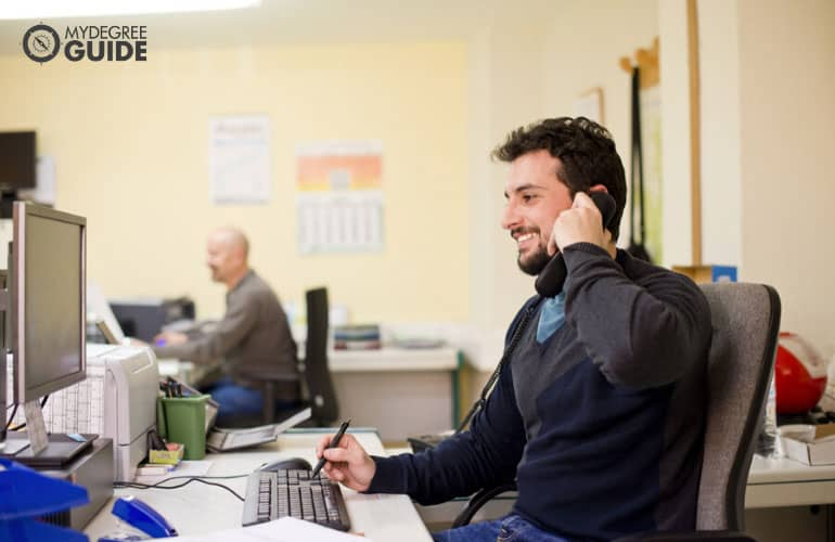 office clerk talking to a client on the phone