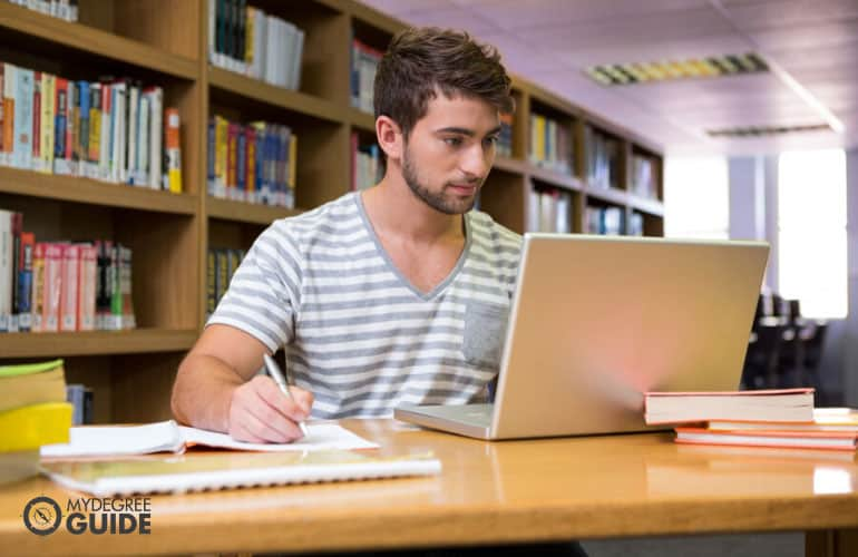 doctorate degree student studying in university library