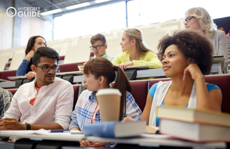 masters degree students sitting in university classroom