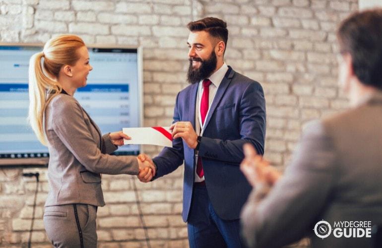 professional receiving a certificate