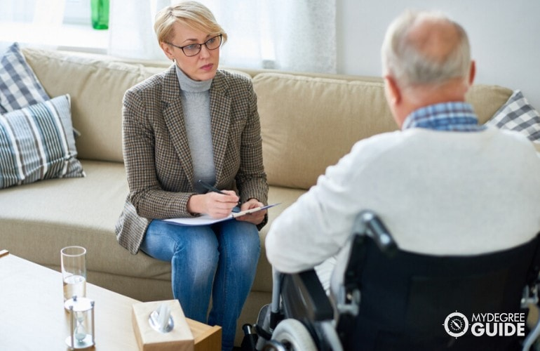 psychologist talking to an elderly patient