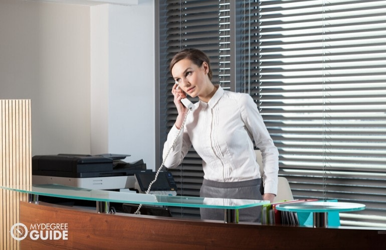 office receptionist talking to client on the phone