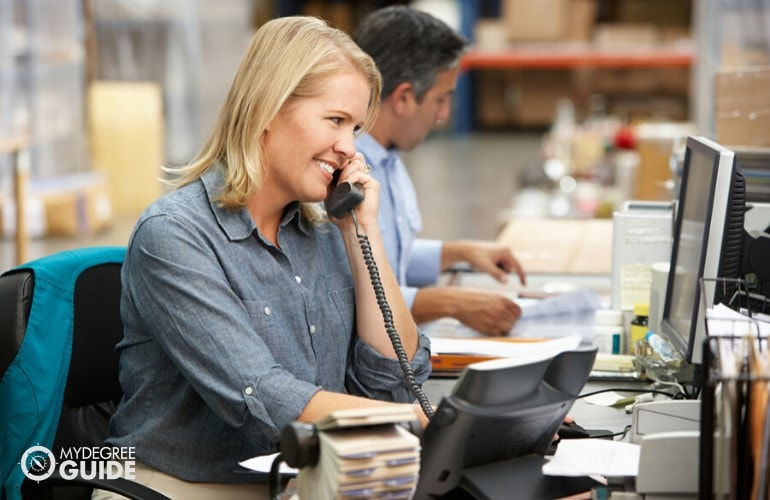 supply chain manager talking to clients on the phone