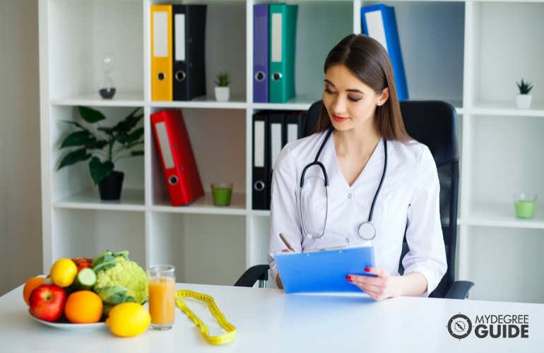 nutritionist working in her office