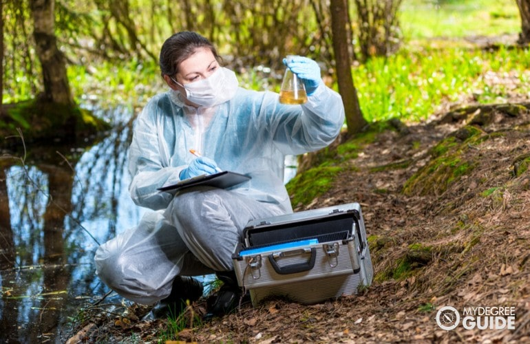 scientist checking water samples from a swamp