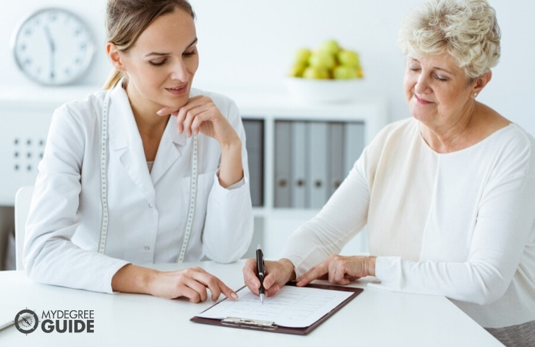 nutritionist with an elderly patient during consultation